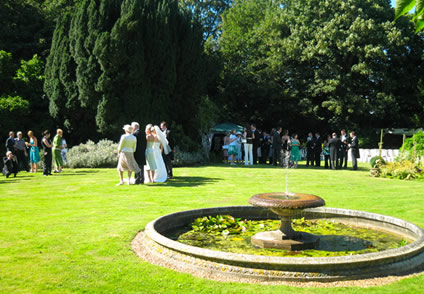 Guests on the lawn at Hartlip Place ceremony